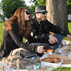 With pizza and snacks on hand, Janine Painchaud, of East Hampton, and Andrew Contant, of Leominster, relax on a blanket and enjoy Thursday's kick off of the Leominster Summer Concert Series at Carter Park.
