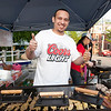 Luis Galarza, of Leominster, serves up food during Thursday's Leominster Summer Concert Series kick off at Carter Park.