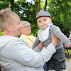 Ryder Contois, 5 months, dances on his grandmother's lap, Sandy Contois, of Fitchburg during Thursday's Leominster Summer Concert Series kick off at Carter Park.