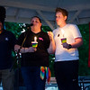 Justo Diaz and Amanda Quin look on while Kellie Coleman speaks during a vigil held on Fitchburg's Upper Common in remembrance of the Orlando shooting victims. SENTINEL & ENTERPRISE / Ashley Green