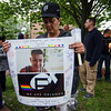 Aida Maldonado holds a poster during a vigil in remembrance of the Orlando shooting victims on Monday evening on the Fitchburg Upper Common. Pictured on the poster is former Leominster resident Jeffrey Rodriguez who was wounded in the shooting. SENTINEL & ENTERPRISE / Ashley Green