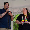 Kellie Coleman looks on while Justo Diaz speaks during a vigil held on Fitchburg's Upper Common in remembrance of the Orlando shooting victims. SENTINEL & ENTERPRISE / Ashley Green