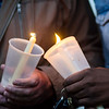 Two people light their candles during a vigil held on Fitchburg's Upper Common in remembrance of the Orlando shooting victims. SENTINEL & ENTERPRISE / Ashley Green