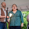 """Christi Frink looks on as Wil Darcangelo and Lavender Bell sing """"Somewhere over the Rainbow"""" during a vigil in remembrance of the Orlando shooting victims on Monday evening on the Fitchburg Upper Common. SENTINEL & ENTERPRISE / Ashley Green"""