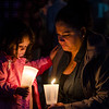 Maria LeBlanc and daughter Gabby, 3, light candles during a vigil in remembrance of the Orlando shooting victims on Monday evening on the Fitchburg Upper Common. LeBlanc's sister, Omayra Velez, lives in Tampa, FL and had previously planned to attend the Pulse nightclub on Saturday evening before deciding to stay home for the evening instead. SENTINEL & ENTERPRISE / Ashley Green