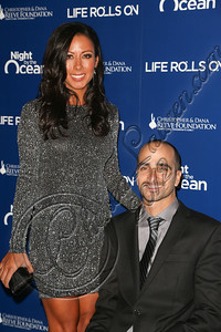 "MARINA DEL REY, CA - NOVEMBER 10:  Life Rolls On founder Jesse Billauer (R) arrives at the Life Rolls On foundation's 9th annual ""Night by the Ocean"" gala at Ritz Carlton Hotel on November 10, 2012 in Marina del Rey, California.  (Photo by Chelsea Lauren/WireImage)"