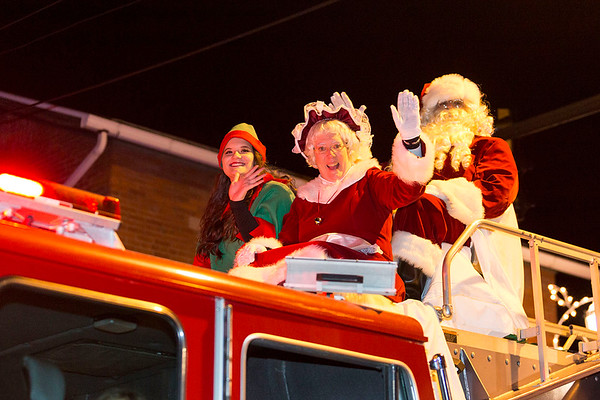 Next Level Photographers<br /> Santa and Mrs. Claus wave to parade-goers.