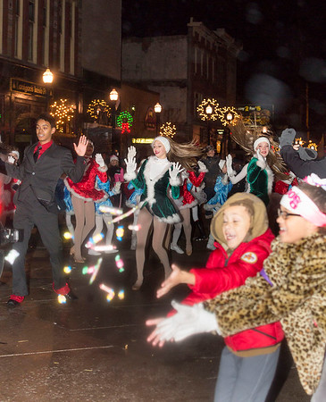 Next Level Photographers<br /> There was dancing -- and candy --  in the streets during the 2015 Light-Up Night Parade in downtown New Castle.