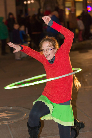 Next Level Photographers<br /> A parade participant performs a routine with an illuminated hula hoop.