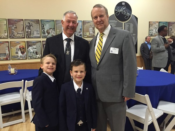Former NDHS President Br. William Nick (left) with Fritz B. Burns President Rex Rawlinson and his grandchildren.