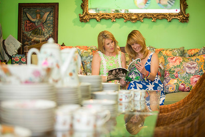 Photo: Jacek Gancarz. Caption: Friday, February 21, 2014 - Photo: Jacek Gancarz. Caption: Friday, February 21, 2014, L-R, Susan Trader of Cape Coral, Fla. and Michele Baymor of Philadelphia, look through a catalog during a preview of property from the estate of Lilly Pulitzer of Palm Beach, Fla. The auction takes place Saturday, February 22, 2014.