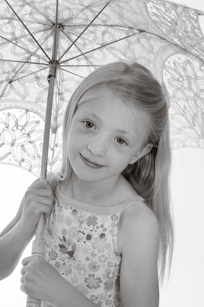 pretty blonde girl holding a lace parasol, isolated on white background
