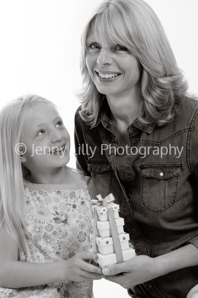 pretty blonde girl and her mum, giving presents, isolated on white background