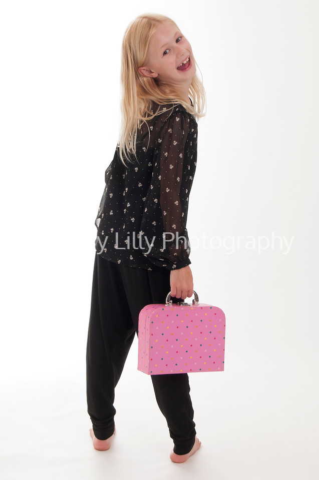 pretty blonde girl with a pink suitcase, isolated on white background