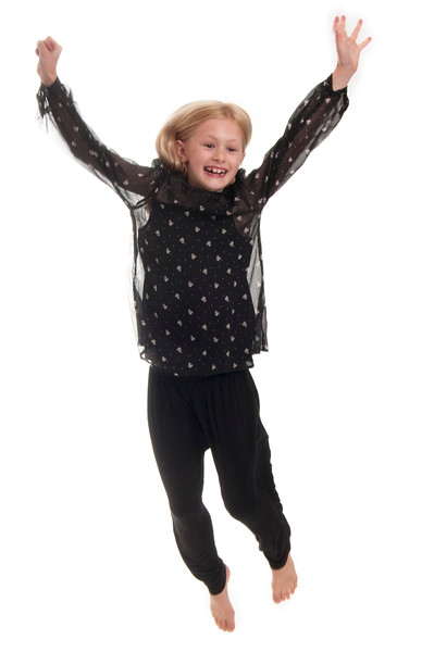 pretty blonde child jumping in the air, isolated on white