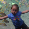 Friday, August 3, 2012 - Kayla Lim pretending like she is swimming with the fish at SeaWorld