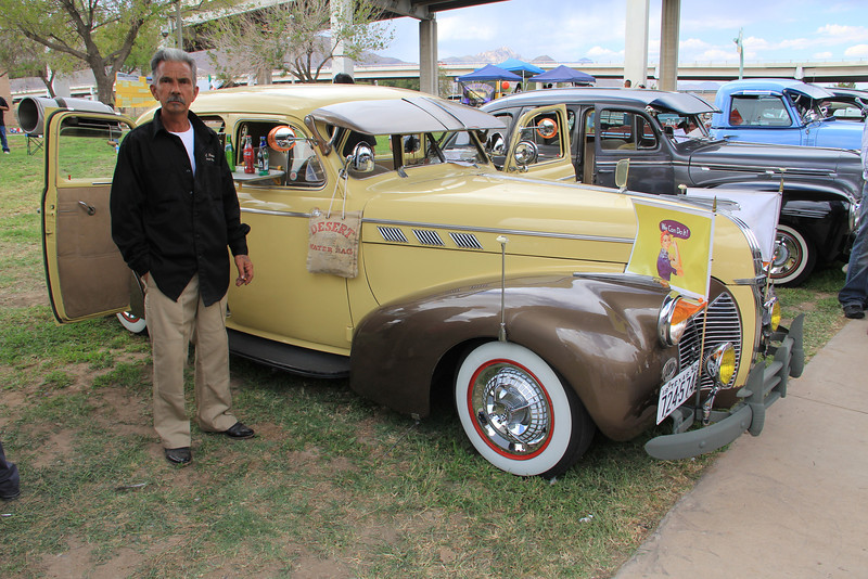 """A 1940's Pontiac restored to original condition was built as a tribute to the victims of the attack on Pearl Harbor. Unknown to the restorer, the gentleman in the picture, it is the some color as the one that appears in the box office hit """"Pearl Harbor"""". The car is decorated with a car-hoop tray complete with a bottle of Coca-Cola, and WWII war propaganda posters. This was my personal favorite."""