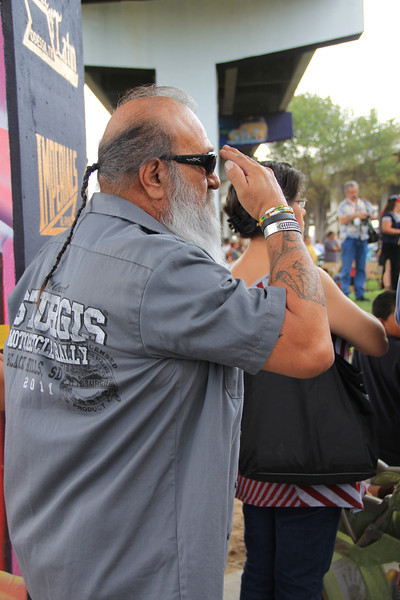 Retired Army man saluting the flag during the national anthem. El Paso is home to Ft. Bliss, one of the largest US army bases.