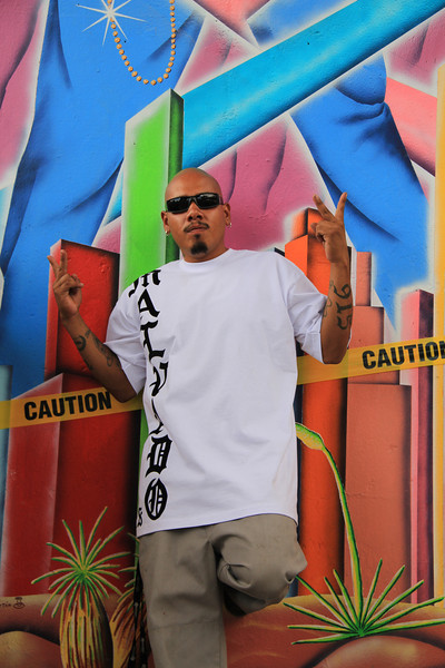Homie, the leader of pack, kindly showed me around the park. In this picture he is posing in front of a highway support pillar that has been painted with a mural representing the Chicano culture of the border city.