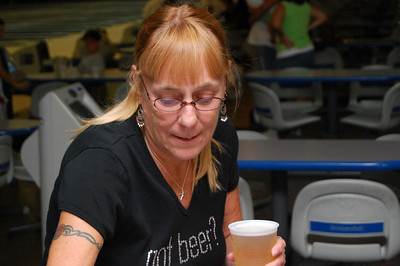 17 Donna is about to sip the OFFICIAL SPORT DRINK of Ormond Lanes