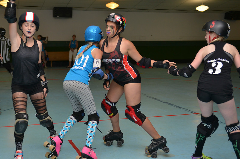 Justin Sheely | The Sheridan Press<br /> Little Devils blockers, from left, Kyenne Weeks, Maria Jensen and Sarah Johnson block Billings jammer Jordynn Peters (201) during the Junior Roller Derby mixer at Scotty's Skate Castle Saturday, June 23, 2018. The Bomber Mountain Little Devils team, comprised of competitors from Sheridan, Buffalo and Gillette, hosted teams from Billings for roller derby battle at Scotty's.