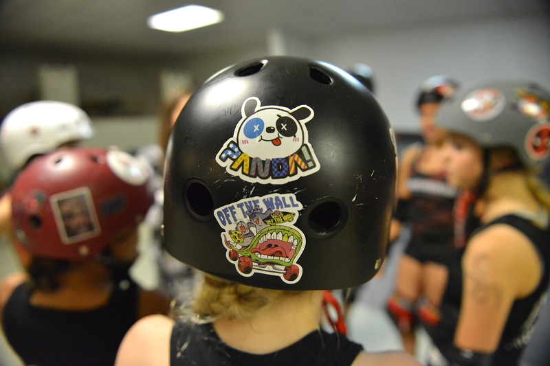 Justin Sheely | The Sheridan Press<br /> The Little Devils huddle during the Junior Roller Derby mixer at Scotty's Skate Castle Saturday, June 23, 2018. The Bomber Mountain Little Devils team, comprised of competitors from Sheridan, Buffalo and Gillette, hosted teams from Billings for roller derby battle at Scotty's.