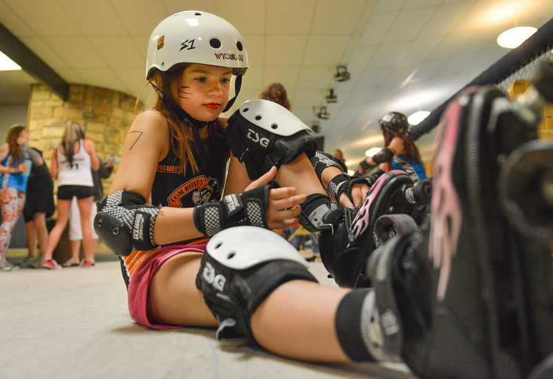 Justin Sheely | The Sheridan Press<br /> Little Devils player Morgan Schell, 11, tightens her skates during the Junior Roller Derby mixer at Scotty's Skate Castle Saturday, June 23, 2018. The Bomber Mountain Little Devils team, comprised of competitors from Sheridan, Buffalo and Gillette, hosted teams from Billings for roller derby battle at Scotty's.