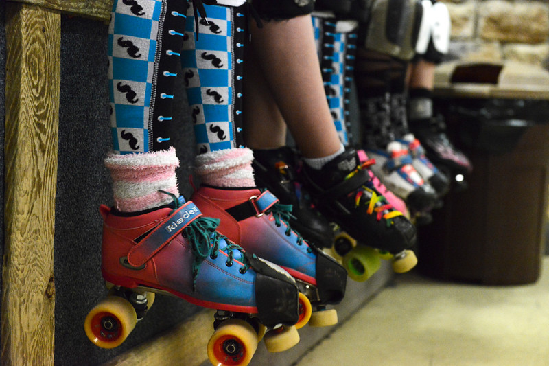 Justin Sheely | The Sheridan Press<br /> Players sit on the skate checkout counter during the Junior Roller Derby mixer at Scotty's Skate Castle Saturday, June 23, 2018. The Bomber Mountain Little Devils team, comprised of competitors from Sheridan, Buffalo and Gillette, hosted teams from Billings for roller derby battle at Scotty's.