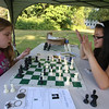 Third Thursday activities at Fay Park in Littleton. Katie Asselin, left, and Lily Morey, both 13 and from Littleton, play chess. (SUN/Julia Malakie)