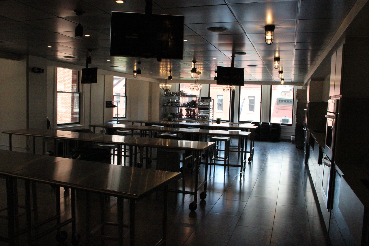 A cooking demonstration room can seat about three dozen class participants.