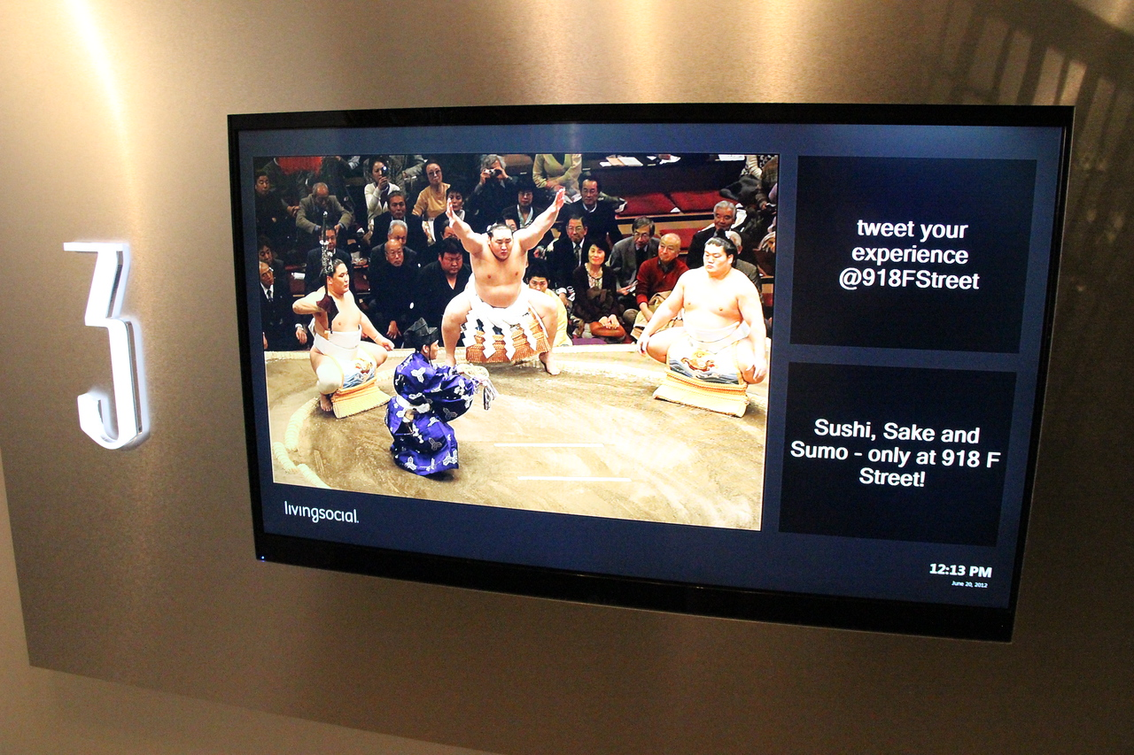 "Later, the third floor screen promotes a ""Sushi, Sake and Sumo"" class."