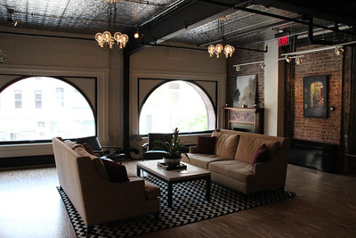 Exposed brick, large windows, wood floors and ornate ceilings exist throughout the building.