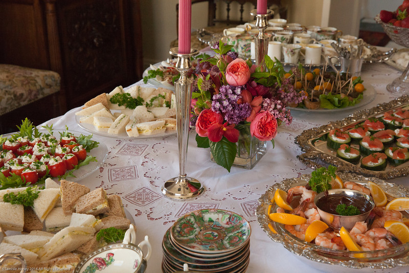 Early grey tea, delicate tea sandwiches, stuffed tomatoes, stuffed endive, shrimp with cocktail sauce, cucumber/salmon bites, marinated mushrooms, Mexican wedding cakes, fresh strawberries, pot de creme, lemon mousse...delectible, delightful, decadent....