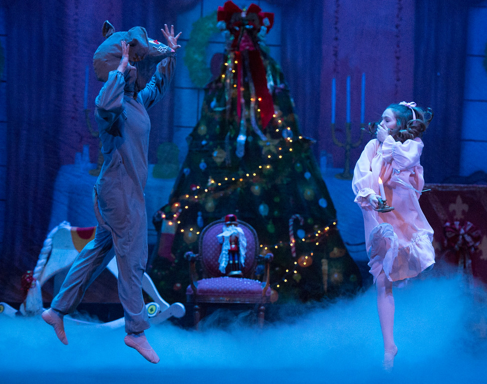 Justin Sheely | The Sheridan Press	<br /> Clara, played by Billings, Montana, dancer Macey Groener, reacts as a giant rat leaps out during a dress rehearsal of the San Diego Ballet's Nutcracker Tuesday at the Whitney Center for the Arts Concert Hall. Local dance students play roles in the sold-out ballet performances this week.