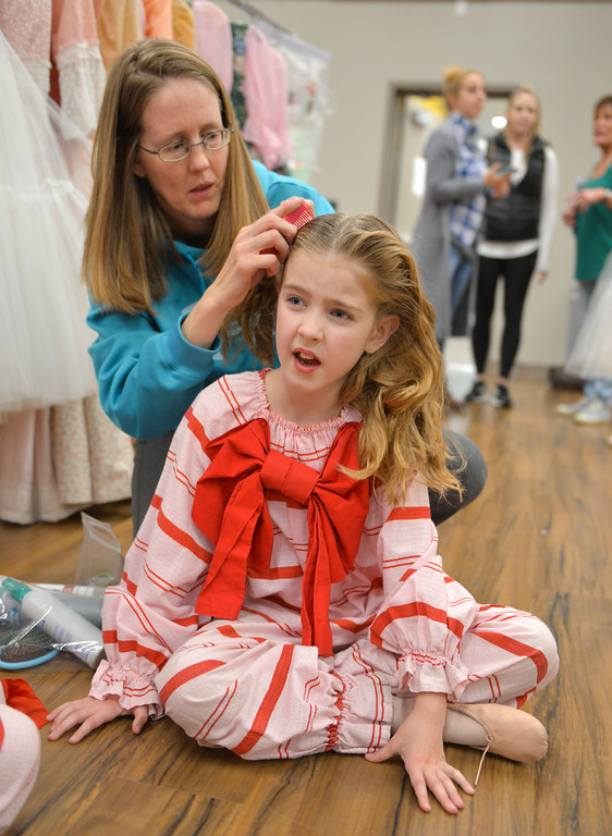 Justin Sheely | The Sheridan Press	<br /> Eight-year-old Alexis Evans reacts as her mother Jennifer Evans makes her hair in the dressing room during a dress rehearsal of the San Diego Ballet's Nutcracker Tuesday at the Whitney Center for the Arts. Local dance students play roles in the sold-out ballet performances this week.