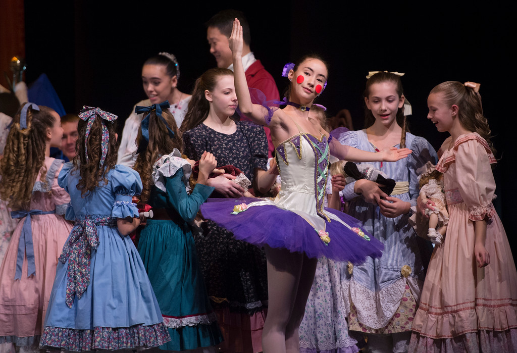 Justin Sheely | The Sheridan Press	<br /> Local dance students marvel at Drosslmeyer's ballerina doll, by Taylor Oshiro,during a dress rehearsal of the San Diego Ballet's Nutcracker Tuesday at the Whitney Center for the Arts Concert Hall. Local dance students play roles in the sold-out ballet performances this week.