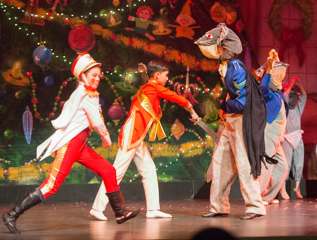 Justin Sheely | The Sheridan Press	<br /> Local dancer Molly Magera, left, runs by as the Nutcracker Prince, Jared Osario, fights the Rat King during a dress rehearsal of the San Diego Ballet's Nutcracker Tuesday at the Whitney Center for the Arts Concert Hall. Local dance students play roles in the sold-out ballet performances this week.
