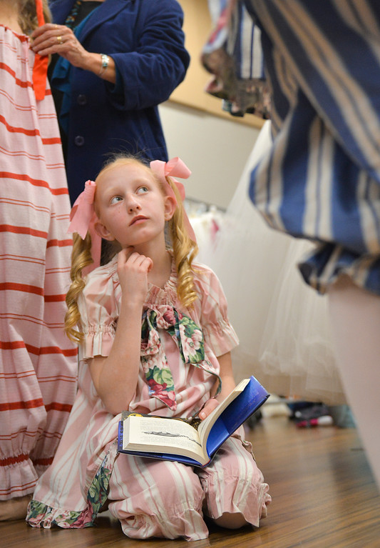 Justin Sheely | The Sheridan Press	<br /> Ten-year-old candy cane Brooklyn Lewis looks up from her book as dancers get ready in the dressing room during a dress rehearsal of the San Diego Ballet's Nutcracker Tuesday at the Whitney Center for the Arts. Local dance students play roles in the sold-out ballet performances this week.