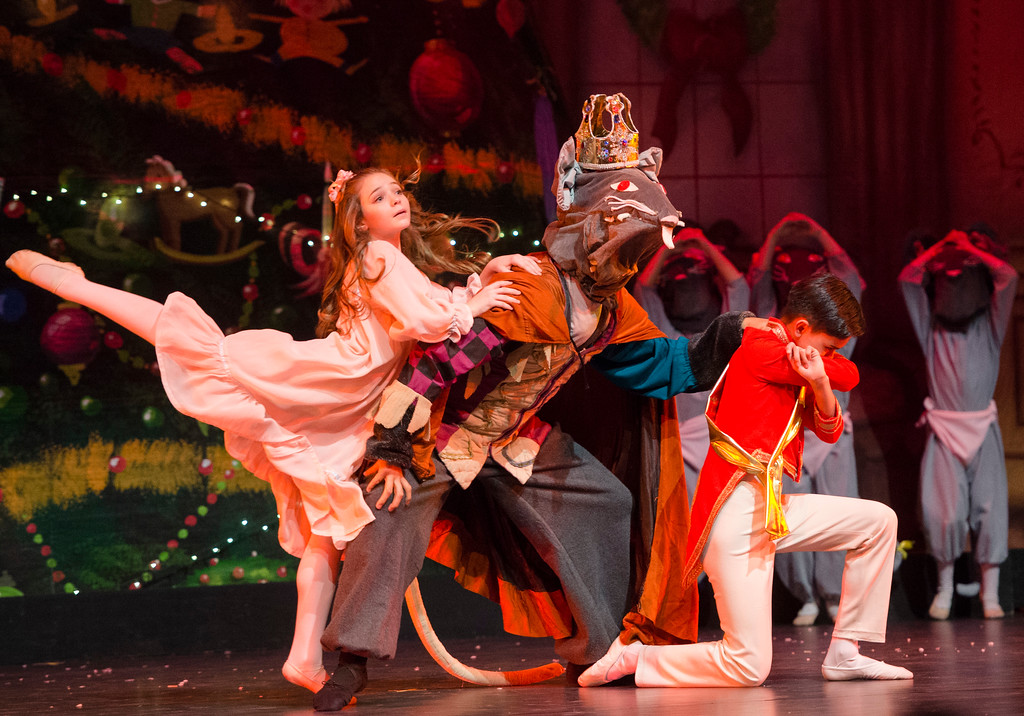 Justin Sheely | The Sheridan Press	<br /> Macey Groener as Clara reacts as the Rat King overcomes the Nutcracker Prince, Jared Osario, during a dress rehearsal of the San Diego Ballet's Nutcracker Tuesday at the Whitney Center for the Arts Concert Hall. Local dance students play roles in the sold-out ballet performances this week.