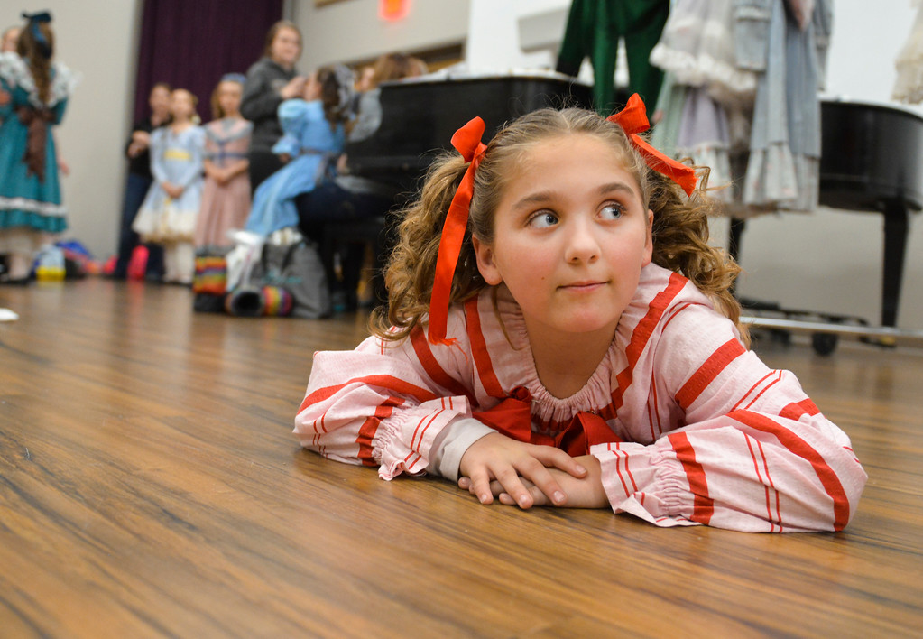 Justin Sheely | The Sheridan Press	<br /> Nine-year-old candy cane Joanne Kahm watches other dancers get ready in the dressing room during a dress rehearsal of the San Diego Ballet's Nutcracker Tuesday at the Whitney Center for the Arts. Local dance students play roles in the sold-out ballet performances this week.