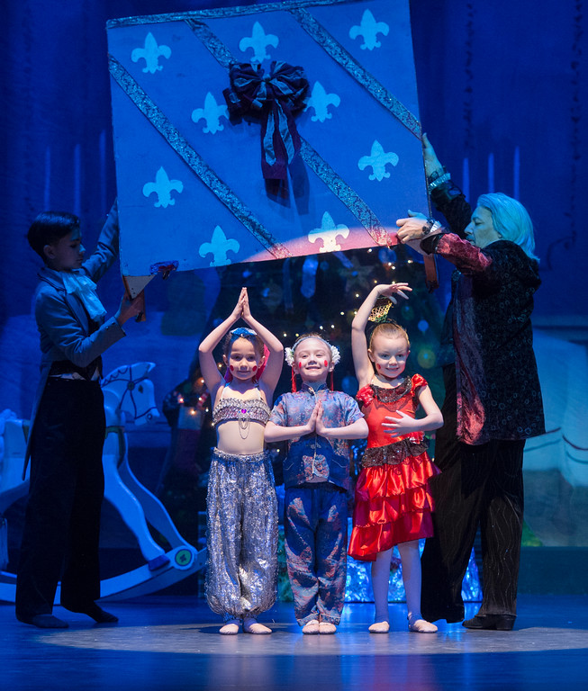 Justin Sheely | The Sheridan Press	<br /> God father Drosslmeyer opens a box of dancing baby dolls, from left, Adaline Cook, Holly Biteman and Morgan Newman during a dress rehearsal of the San Diego Ballet's Nutcracker Tuesday at the Whitney Center for the Arts Concert Hall. Local dance students play roles in the sold-out ballet performances this week.