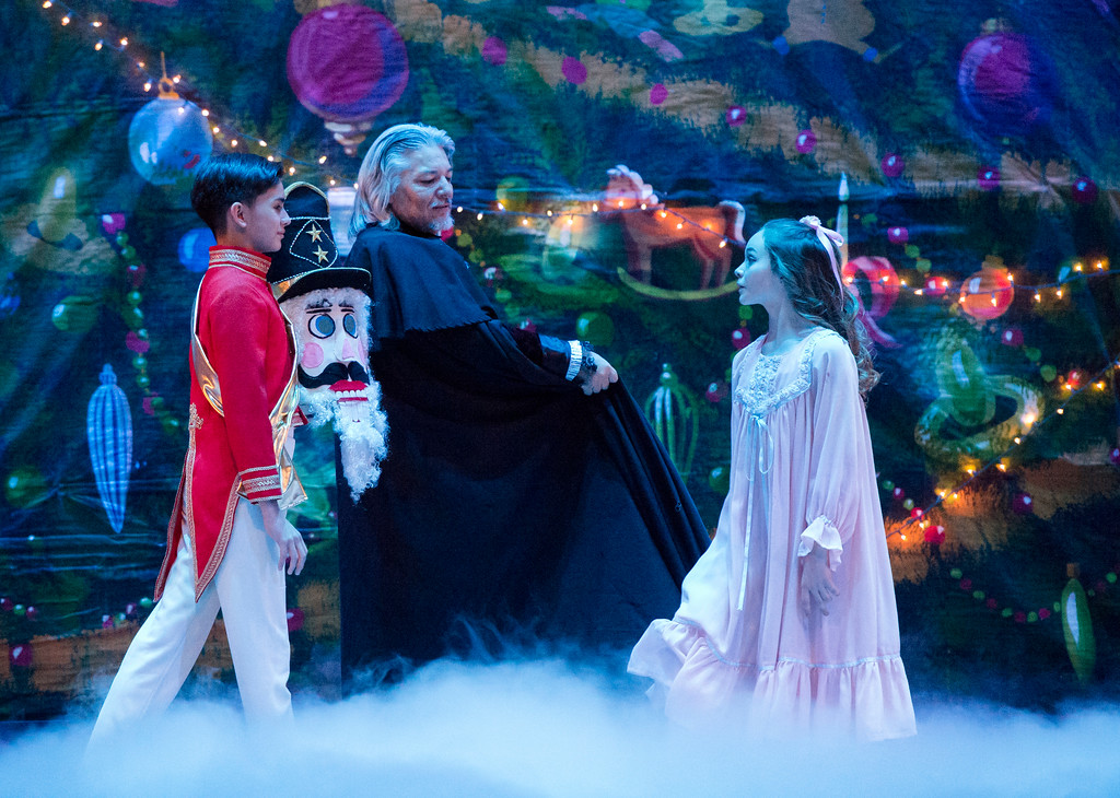 Justin Sheely | The Sheridan Press	<br /> The Nutcracker Prince, Jared Osario, is presented to Carla, Macey Groener, by her god father Drosslmeyer, center, during a dress rehearsal of the San Diego Ballet's Nutcracker Tuesday at the Whitney Center for the Arts Concert Hall. Local dance students play roles in the sold-out ballet performances this week.