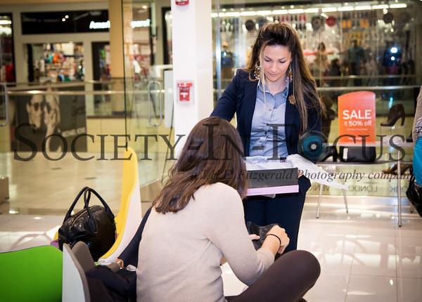 Naomi Kurthi assisting a customer