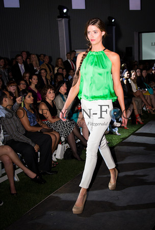 Runway Model in Green Shirt and White Pants