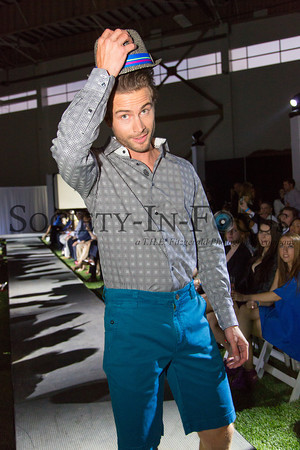 Runway Model Tipping His Hat