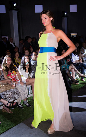 Runway Model in Yellow and Tan Dress with Blue Sash