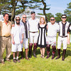 Guests pose with a Polo Player