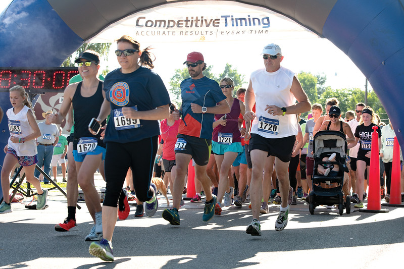 Matthew Gaston | The Sheridan Press<br>Participants in the Longmire Days 5K race off the starting line in Prosinski Park Friday, July 19, 2019.