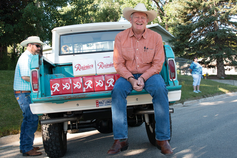Matthew Gaston | The Sheridan Press<br>Author Craig Johnson sits on the back of a 1964 Ford Bronc patiently waiting to reward the participants of the Longmire Days 5K with a cold Rainer beer Friday, July 19, 2019.