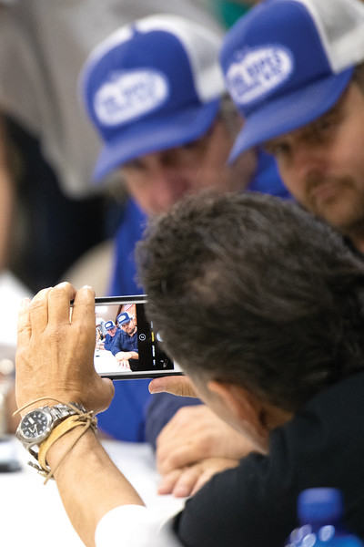 Matthew Gaston | The Sheridan Press<br>Actor Adolph Martinez takes a photo of his co-stars Robert Taylor, left, and Adam Bartley from the hit television series Longmire in matching King's Ropes hats Friday, July 19, 2019.